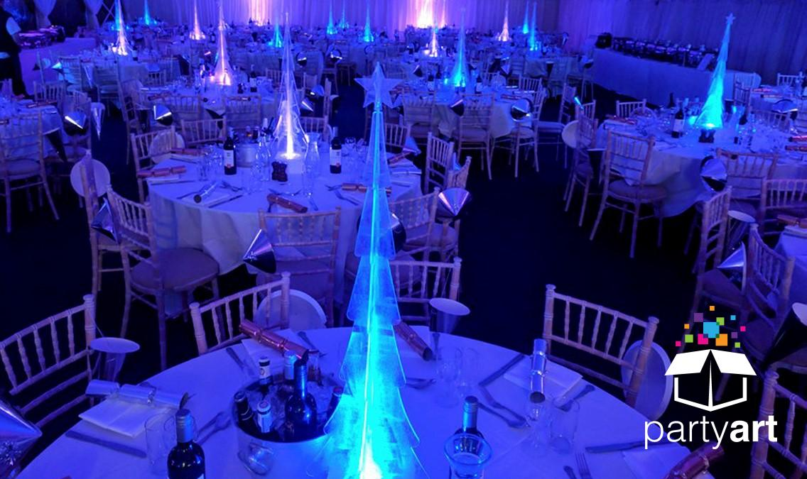 A customised LED table centrepiece of a frosted Christmas tree for a Christmas themed party