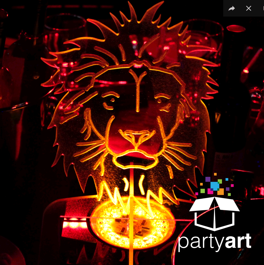 A customised lit table centre shaped like a lion